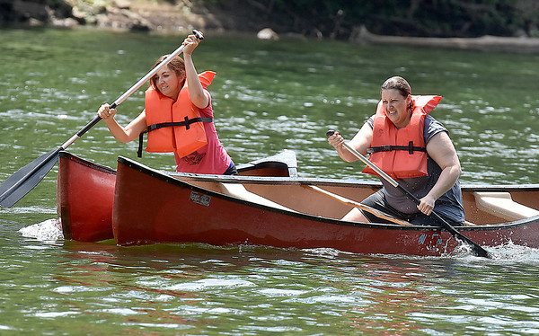 (Brad Davis/The Register-Herald) A fierce battle ensues down the stretch between Elizabeth Copenhaver, right, and Joan St. Clair during the Alderson Canoe Races Sunday afternoon.