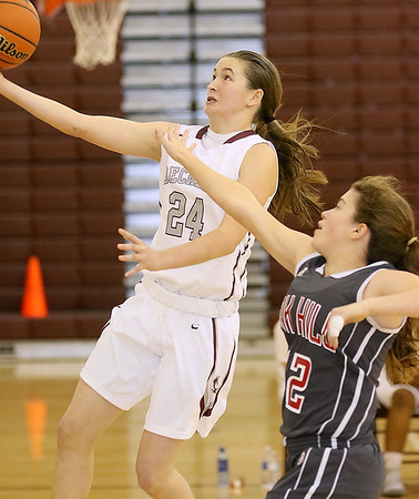 (Brad Davis/The Register-Herald) Woodrow Wilson's Liz Cadle drives to the basket as Oak Hill's Chelsea Pack defends Wednesday night in Beckley.