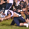 (Brad Davis/The Register-Herald) Independence's Connor Gibson is taken down by Summers County defenders Christian Pack, left, and Ethan Koenig Friday night in Hinton.