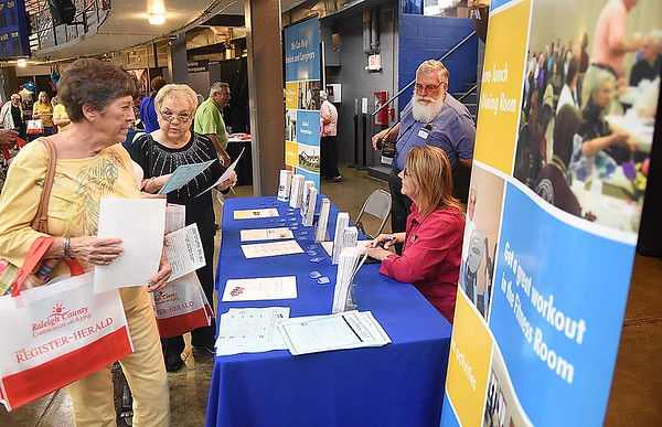 Seniors visiting the Raleigh County Commission on Aging booth during the Senior Day Out at the Beckley Raleigh County Convetion Center.<br /> (Rick Barbero/The Register-Herald)