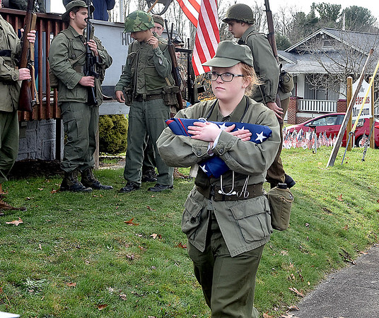 (Brad Davis/The Register-Herald) Woodrow Wilson JROTC 3rd-year cadet Alissa Kirby carries the folded flag, which was flown during special memorial services for the USS West Virginia at Pearl Harbor, to be officially donated to the Raleigh County Veterans Museum's during its 4th annual Healing Fields Ceremony Saturday afternoon.