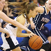 (Brad Davis/The Register-Herald) Shady Spring's Bri Reed speeds between Independence defenders Alexis Bolen, left, and Nicole Kester Thursday night in Shady Spring.