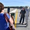 (Brad Davis/The Register-Herald) Temperance, Michigan residents Mike and Nathalie Jacobs can't resist a photo with Beetlejuice, a.k.a. Ace Adventure Resort's Chris Colin, who was on hand promoting the park's haunted houses during Bridge Day Saturday afternoon.