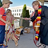 (Brad Davis/The Register-Herald) Beckley youngsters Ben Terry, 8, and sister Evie Hilton, 6, look on as their dog Cruiser is blessed by Rev. Julie Hay Halstead, lead pastor for Raleigh Shared Ministries during the annual Blessing of the Animals Sunday afternoon under the Word Park gazebo.