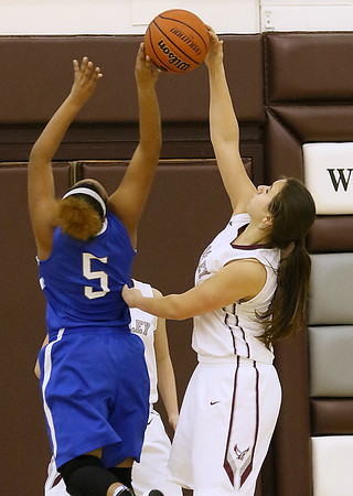 (Brad Davis/The Register-Herald) Woodrow Wilson's Madison Miller blocks a layup attempt by Capital's Alex Gray Wednesday night in Beckley.