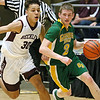 (Brad Davis/The Register-Herald) Greenbrier East's Seth Brown drives to the basket as Woodrow Wilson's Eddie Christian defends Friday night at the Beckley-Raleigh County Convention Center.