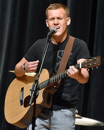 (Brad Davis/The Register-Herald) 14-year-old Noah Spencer performs during the Friends of Coal Women's Auxiliary's annual Talent Show Fundraising event Saturday afternoon at the Woodrow Wilson High School Auditorium.