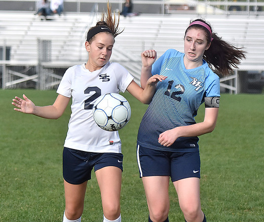 (Brad Davis/The Register-Herald) Shady Spring's Sidney Moneypenny battles for possession with Midland Trail's Mykah Price Thursday evening at the YMCA Paul Cline Memorial Soccer Complex.