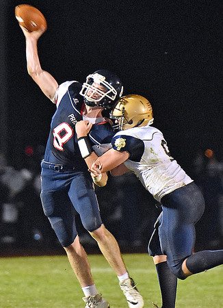 (Brad Davis/The Register-Herald) Independence quarterback Adam Daniels is caught and hit by Shady Spring's Jaron Bragg as he tries to throw Friday night in Coal City.
