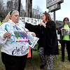 (Brad Davis/The Register-Herald) Mother Leisa Wellington, 2nd from left, joins friends and family as they stand along the road holding a candles and signs for son Chaz Richardson, who has been missing since December 3rd of 2015 during a vigil and continued awareness gathering Wednesday evening in Glen Daniel next to the Whitesville State Bank. She is joined at far left by family friends Dave Shannon, Carla Music-Webster to her right and several other friends and family members.