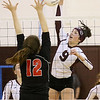 (Brad Davis/The Register-Herald) Woodrow Wilson's Sydney McClung tries to make a kill as St. Albans' Brooke Clark tries to block it Saturday afternoon at Woodrow Wilson High School.