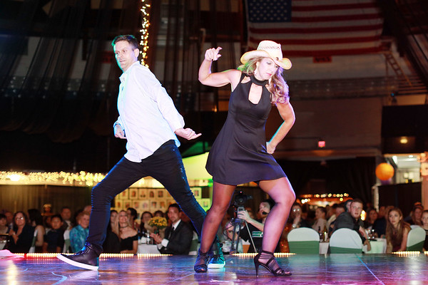 Jude Zilokowski and Karen Johnson perform during 6th annual United Way of Southern West Virginia's Dancing With the Stars at the Beckley-Raleigh County Convention Center in Beckley on Friday. (Chris Jackson/The Register-Herald)