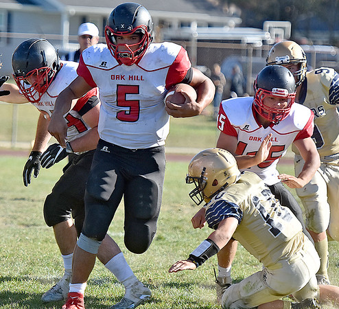 (Brad Davis/The Register-Herald) Oak Hill's Christian Lively carries the ball Saturday afternoon in Shady Spring.