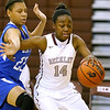 (Brad Davis/The Register-Herald) Woodrow Wilson's Sydni Darden drives around Capital's Danijah Allen Wednesday night in Beckley.