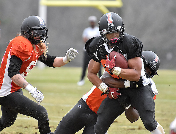 (Brad Davis/The Register-Herald) South (black) running back Kelsey Young rumbles ahead during Spring League action Sunday afternoon in White Sulphur Springs.