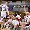 (Brad Davis/The Register-Herald) Crossroads Chevy's (Class AAA) Luke Frampton, left, is congratulated by his fellow all stars after winning the three-point competition during the Scott Brown memorial game Saturday evening at the Beckley-Raleigh County Convention Center.
