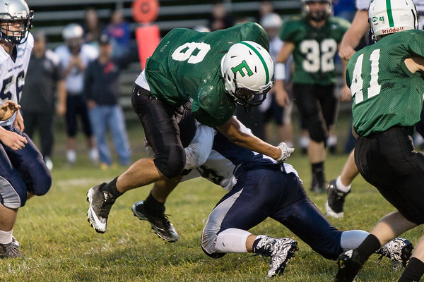 A Valley Greyhound pops Jordan Dempsey up off the ground. Chad Foreman for the Register-Herald.