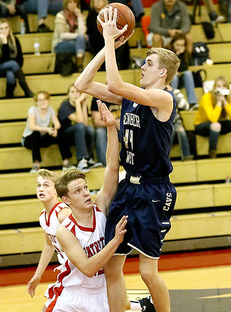 (Brad Davis/The Register-Herald) Greenbrier West's Collin O'Dell pulls up for a short-range jumper as Independence's Logan Stump Friday night in Coal City.