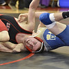 (Brad Davis/The Register-Herald) Oak Hill's Dawson Vincent, left, takes on Greenbrier West's Dan Nutter in a 126-pound weight class matchup during the Class AA/A Region 3 Tournament Friday night at Independence High School. Oak Hill's Vincent won the match.