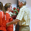 (Brad Davis/The Register-Herald) Greater Beckley Christian's Lydia Jordan receives flowers from grandfather Mike Reed after notching her 1,000th career kill against Ravenswood Saturday afternoon in Prosperity.