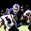 Meadow Bridge's Zachory Yates (18) gets past Webster County's Luke Hardway (31) and Jordan Rose (5) during their high school football game Friday in Meadow Bridge. (Chris Jackson/The Register-Herald)