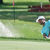 (Brad Davis/The Register-Herald) Tony Finau chips onto the #15 green from a bunker during final round Greenbrier Classic action Sunday afternoon in White Sulphur Springs.
