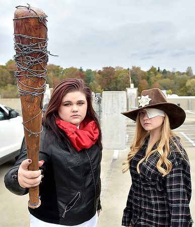 (Brad Davis/The Register-Herald) Tearson McKinney, left, and Alex Craft, fans of The Walking Dead tv show, pose for a quick photo in character as Negan (McKinney) and Carl Grimes during Tailgate Halloween Saturday afternoon atop Beckley's Intermodal Gateway.