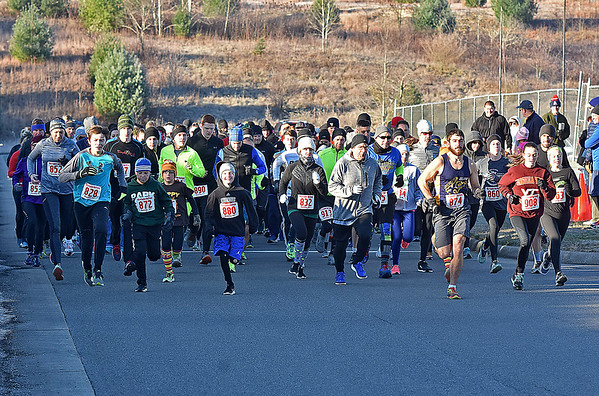 (Brad Davis/The Register-Herald) A huge group of runners and walkers sets off during the YMCA of Southern West Virginia's annual Turkey Trot 5K Walk/Run on a chilly Thanksgiving morning Thursday at the YMCA Paul Cline Memorial Sports Complex.