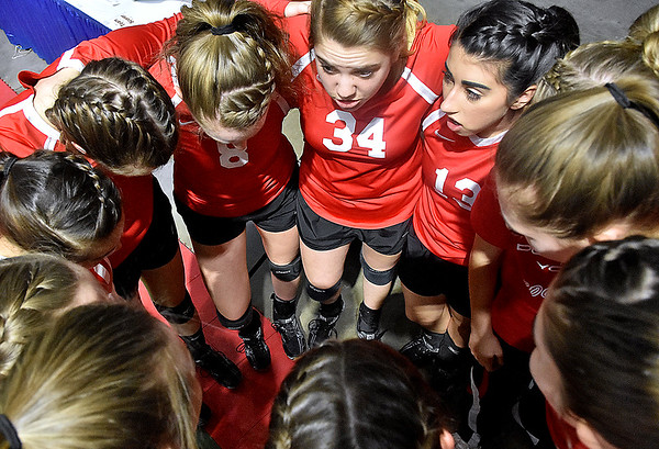 (Brad Davis/The Register-Herald) Greater Beckley Christian players come together to get focused prior to their afternoon match against Moorefield during State Volleyball Tournament action Friday  at the Charleston Civic Center.