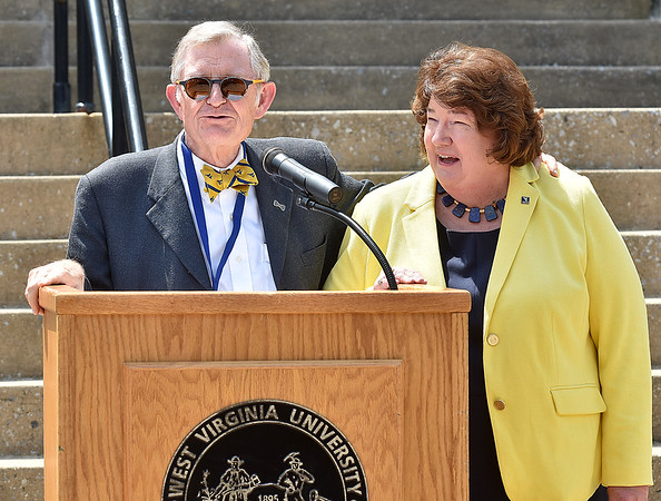 (Brad Davis/The Register-Herald) WVU President E. Gordon Gee puts his arm around WVU tech President Carolyn Long as he heaps praise on her during a speech as part of a brief ceremony marking the first day of classes for Tech on the Beckley campus Wednesday afternoon.