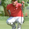 (Brad Davis/The Register-Herald) Sebastian Munoz eyeballs an upcoming putt during first round Greenbrier Classic action Thurdsay afternoon in White Sulphur Springs.