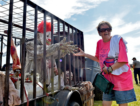 (Brad Davis/The Register-Herald) A passerby cautiously checks out the Zombie Hunter during the Friends of Coal Auto Fair July 15 at the Raleigh County Memorial Airport.