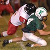 Fayetteville quarterback, Tristian Coots is brought down by Oak Hill's Khalil Gray. Chad Foreman for the Register-Herald