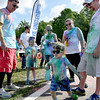 (Brad Davis/The Register-Herald) Three-year-old Ceadmon Adams busts a few dance moves United Way of Southern West Virginia's annual Color Me United Walk/Run Saturday morning at the Raleigh County Memorial Airport.