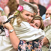 (Brad Davis/The Register-Herald) Kristy Fleenor, mother of graduating Westside senior Alysson Fleenor, gets a smothering hug from Hope Brown during the flower ceremony prior to the school's 2017 Commencement Sunday afternoon in Clear Fork.