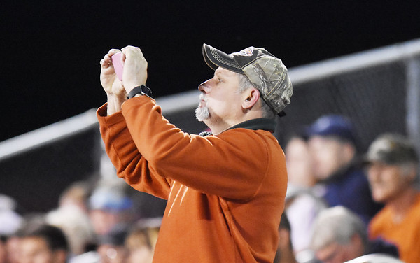 A Meadow Bridge fan takes a photograph of their football game against Webster County Friday in Meadow Bridge. (Chris Jackson/The Register-Herald)