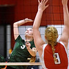 (Brad Davis/The Register-Herald) Fayetteville's Ariel Whaples leaps to spike the ball as Ravenswood's Katie Mellinger steps up to block it Saturday afternoon in Prosperity.