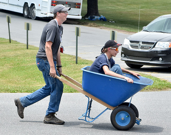 (Brad Davis/The Register-Herald) A pair of scouts get resourceful on the grounds of Jackie Withrow Hospital Thursday afternoon in Beckley.