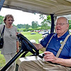 (Brad Davis/The Register-Herald) Daniel Vineyards owner C. Richard Daniel roams around the property in style with a personal golf cart as he and employee Kay Pence chat during Saturday's Wine Fest.