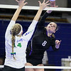 (Brad Davis/The Register-Herald) James Monroe's Jessica King goes for a kill against Robert C. Byrd during State Volleyball Tournament action Friday afternoon at the Charleston Civic Center.