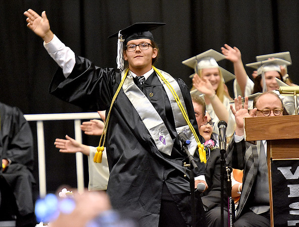 "(Brad Davis/The Register-Herald) Westside senior Mitchell Blackburn gets the crowd waving as he performs ""Free Bird"" during the school's 2017 Commencement Sunday afternoon in Clear Fork."