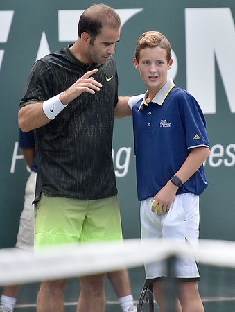 (Brad Davis/The Register-Herald) Ballboy Jaxen Ransom gets a quick scouting report from tennis legend Pete Sampras before getting to plays against James Blake during the Greenbrier Champions Tennis Classic Saturday afternoon in White Sulphur Springs.