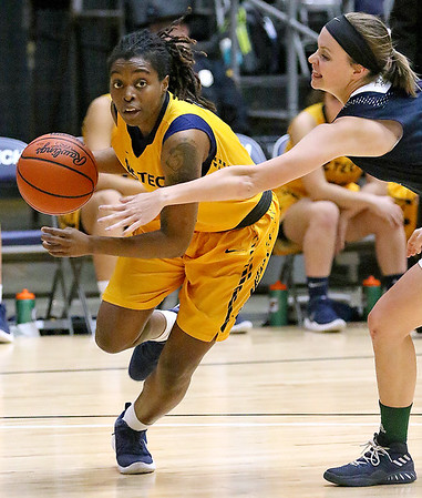 (Brad Davis/The Register-Herald) WVU Tech's Zjhane West drives along the baseline as Mount Vernon Nazarene's Cassidy Cain defends Tuesday night at the Beckley-Raleigh County Convention Center.