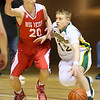 (Brad Davis/The Register-Herald) Greenbrier East's Steven Winnings looks for a way around Parkersburg's Jake Johnson during Big Atlantic Classic action Saturday night at the Beckley-Raleigh County Convention Center.