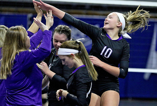(Brad Davis/The Register-Herald) James Monroe's Gracie Mann rushes in for high-fives from coach Lindsay Miller and teammates after clawing out a five-set win over against Robert C. Byrd during State Volleyball Tournament action Friday afternoon at the Charleston Civic Center.