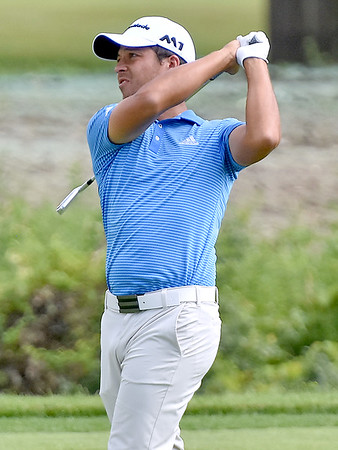 (Brad Davis/The Register-Herald) Xander Schauffele shoots from the fairway on #17 during first round Greenbrier Classic action Thurdsay afternoon in White Sulphur Springs.