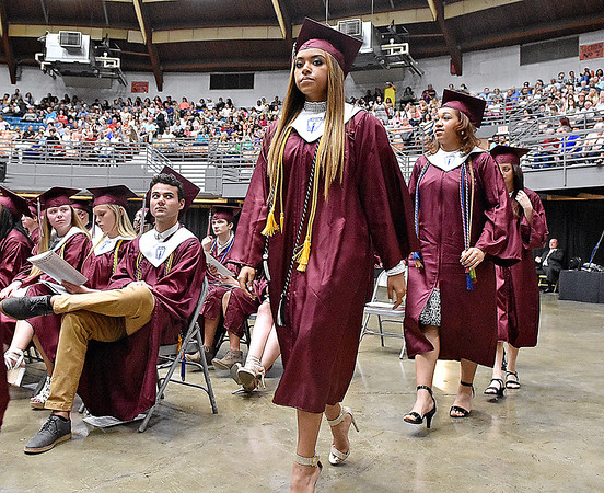 (Brad Davis/The Register-Herald) Woodrow Wilson seniors make their way to the stage to collect their diplomas during the school's 91st Commencement Saturday evening at the Beckley-Raleigh County Convention Center.