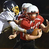 (Brad Davis/The Register-Herald) Trap Hill's Logan Dodrill slips a tackle attempt by Shady Spring's Adam Richmond during the Wildcat's win over the Tigers Thursday night in Glen Daniel.