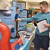 (Brad Davis/The Register-Herald) Judge Jordan Pruett looks over some of the many interesting projects on display during the R.E.S.A. 1 Regional Social Studies Fair Saturday morning at the Beckley-Raleigh County Convention Center. Students from Monroe, McDowell, Raleigh, Summers and Wyoming Counties presented 191 projects with awards going out in nine different categories over three grade divisions (3rd-5th, 6th-8th and 9th-12th).