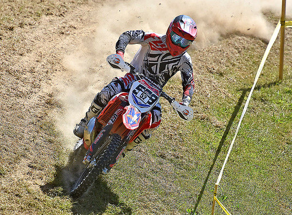 (Brad Davis/The Register-Herald) A competitor tears through a section of the course during Sprint Enduro Series dirt bike racing Sunday afternoon at Hidden Valley Golf in Glen Daniel.